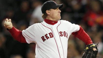 ESPN says commentator Curt Schilling won't appear on the air