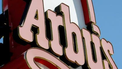 The Arby's fast food chain announced late Thursday that it had fired a Florida restaurant manager and suspended a clerk after a female police officer said she had been denied service because she was a cop.