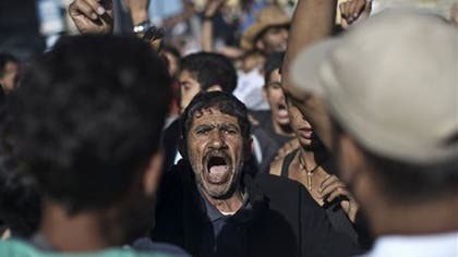 Clashes broke out between police and some , migrants attempting to storm a ferry on the Aegean island of Lesbos Friday, and  migrants broke through a police barricade in Hungary, marching towards the Austrian border as hundreds of thousands of mostly Syrians and Afghans flee the horrors of war, causing the worst refugee crisis in Europe since World War II.