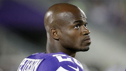 Star Minnesota Vikings running back Adrian Peterson was taken into custody and released on bond in Texas early Saturday morning following his indictment on a charge of ch