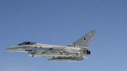 Two F- fighter jets intercepted six Russian military airplanes that neared the western coast of Alaska, military officials said Friday.