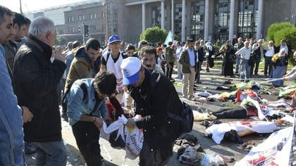 Two bomb explosions targeted a peace rally Saturday by leftist and Kurdish activists in the Turkish capital of Ankara, killing  people and wounding , the country's health minister said.