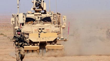 The U.S. military has been stockpiling huge quantities of gear in Kuwait in preparation for shipping it across the border into Iraq for possible use in a coordinated offensive against the terrorist group Islamic State, according to U.S. News  World Report.