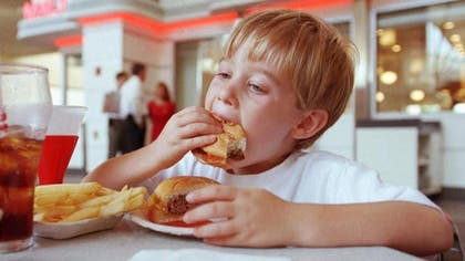 Between  and , the number of U.S. kids eating fast food on any given day went down, and the calories from some types of fast foods have declined as well, according to a new