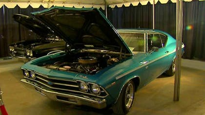 Classic car fans flock to auction.
