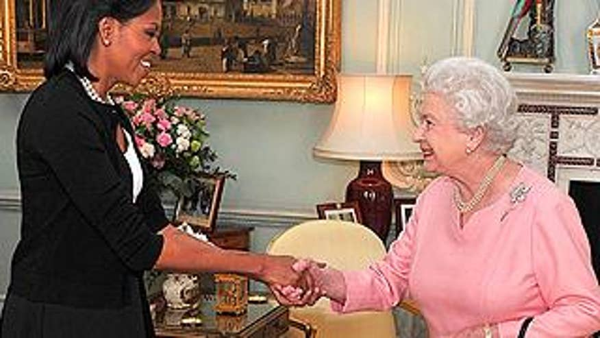 Apr. 1: First lady Michelle Obama is welcomed by Britain's Queen Elizabeth II, as she arrives with President Obama for an audience at Buckingham Palace in London. (AP)