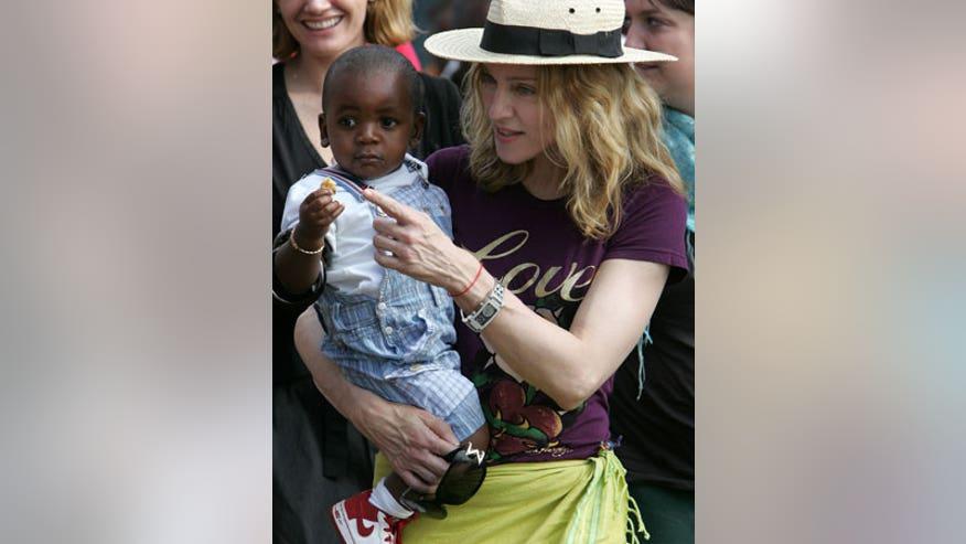 1_21_Madonna_Adoption1