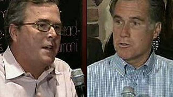 Jeb Bush and Mitt Romney at a Republican-hosted town hall meeting