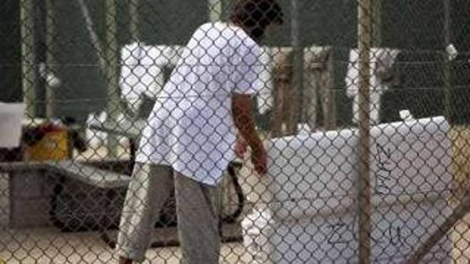 A Guantanamo detainee opens a cooler inside the Guantanamo Bay prison