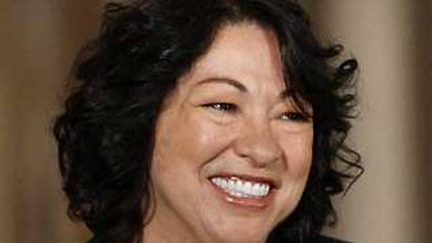 Judge Sonia Sotomayor smiles as President
