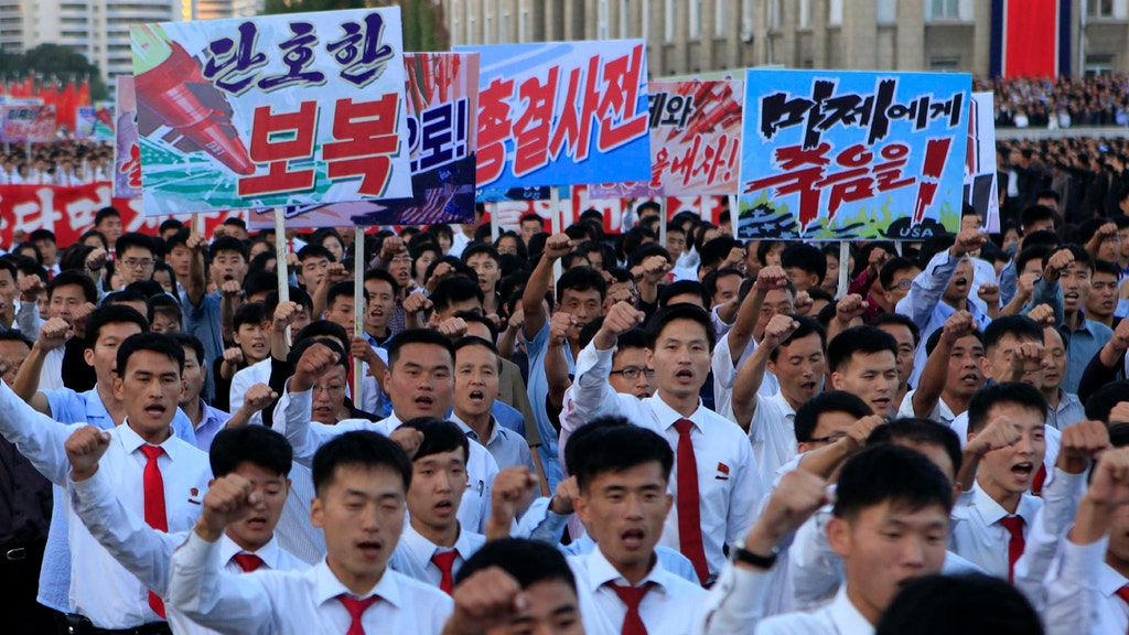 North Koreans march in protest of the president and the U.S.