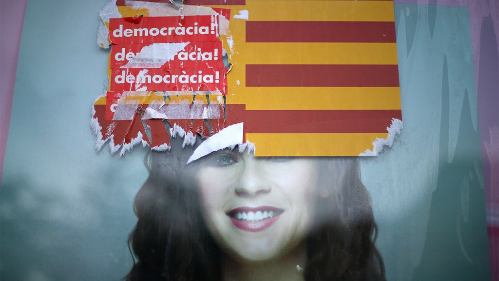 Spain to dissolve region's government to 'restore order' amid independence bid
