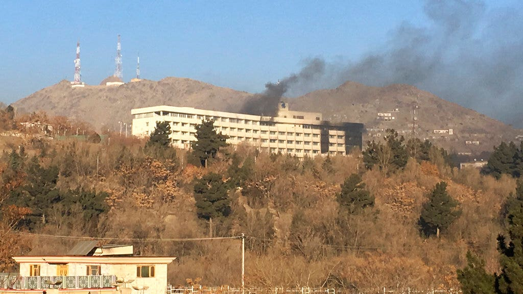 Attackers who launched Kabul hotel massacre may have had help, investigators say