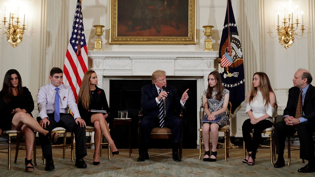 Trump promises change on gun laws following Florida mass shooting