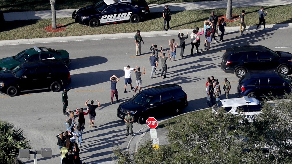 Officers guard home of deputy who did not engage Florida HS gunman: report
