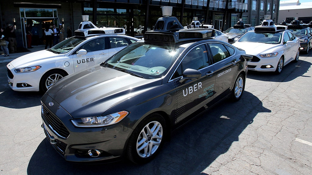 Self-driving Uber car hits pedestrian in first driverless fatality