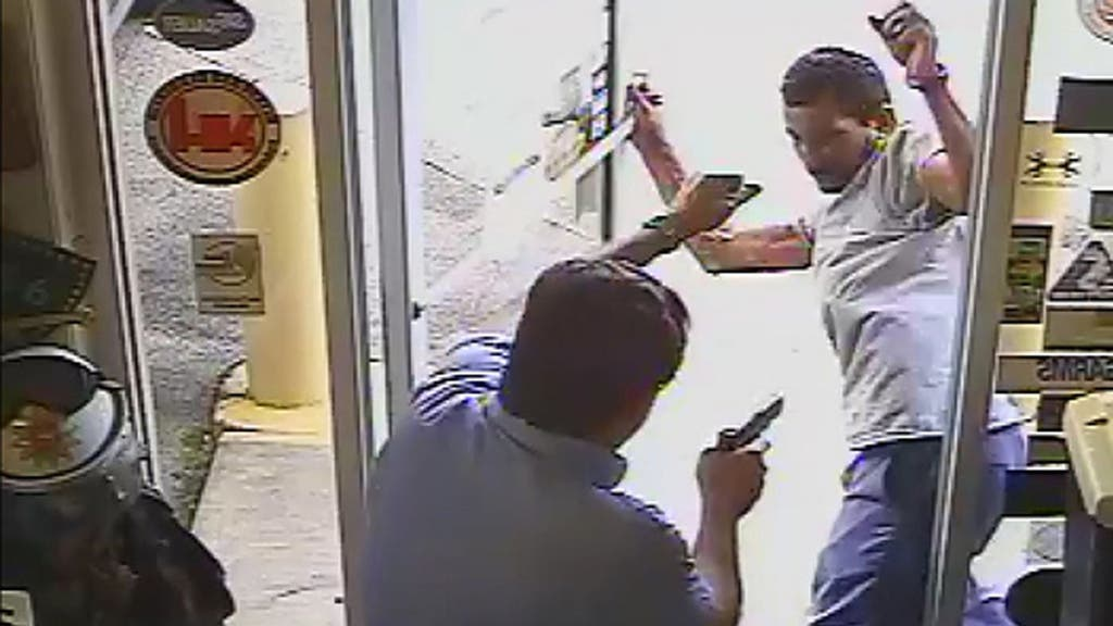 SHOCKING FOOTAGE: Official shoots, kills alleged shoplifter carrying a hatchet