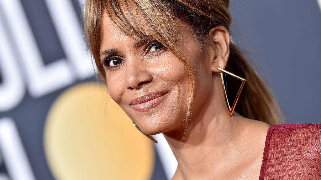 Halle Berry defends latest topless cooking photo, new back tattoo