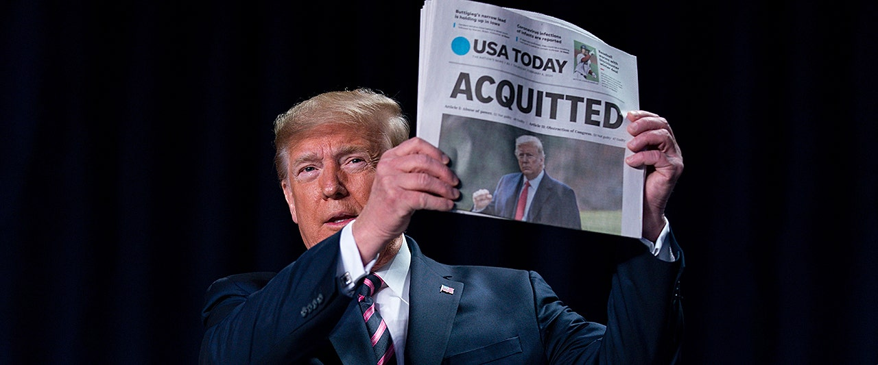 Trump trolls Pelosi at prayer breakfast, brandishes front-page headlines declaring his acquittal