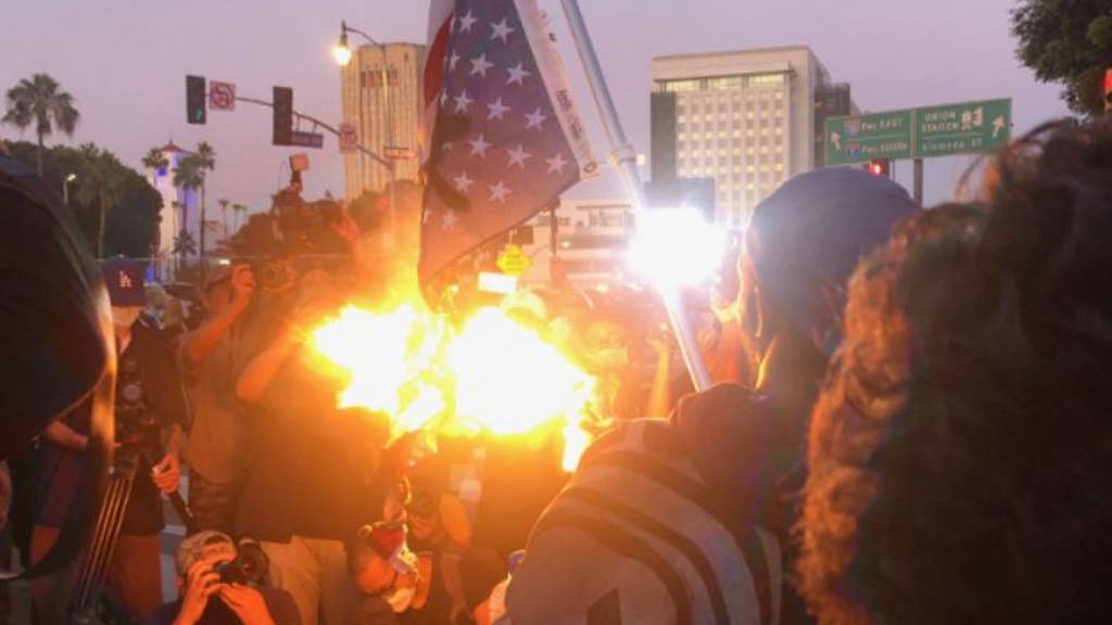 Protests erupt over Floyd death, flag burned, highway blocked
