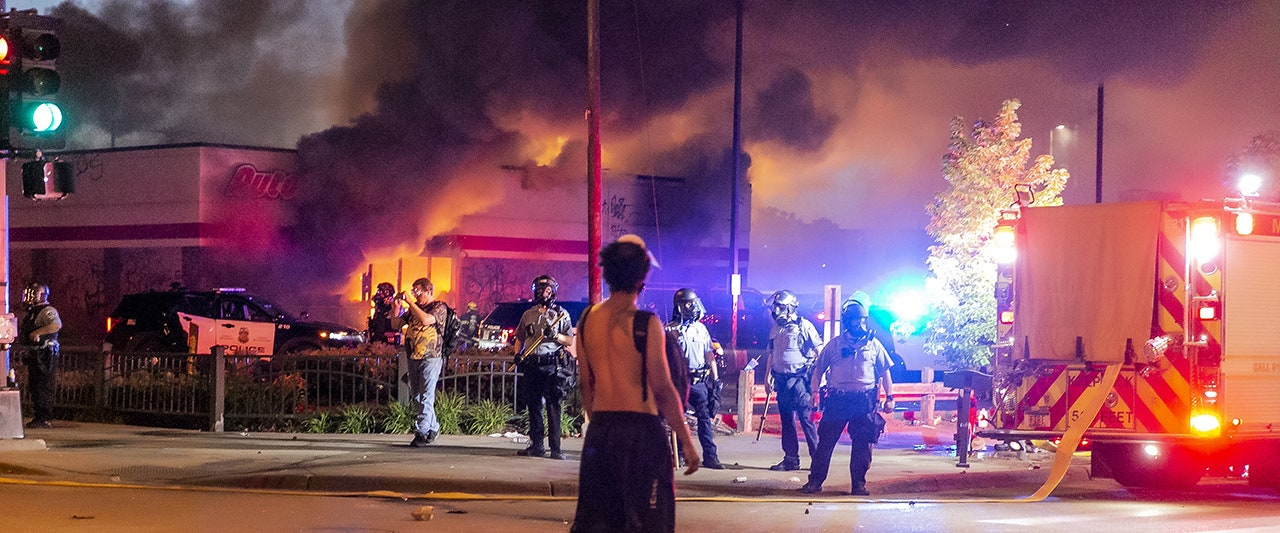 One killed as armed protesters battle police, burn and loot in Minneapolis over George Floyd death