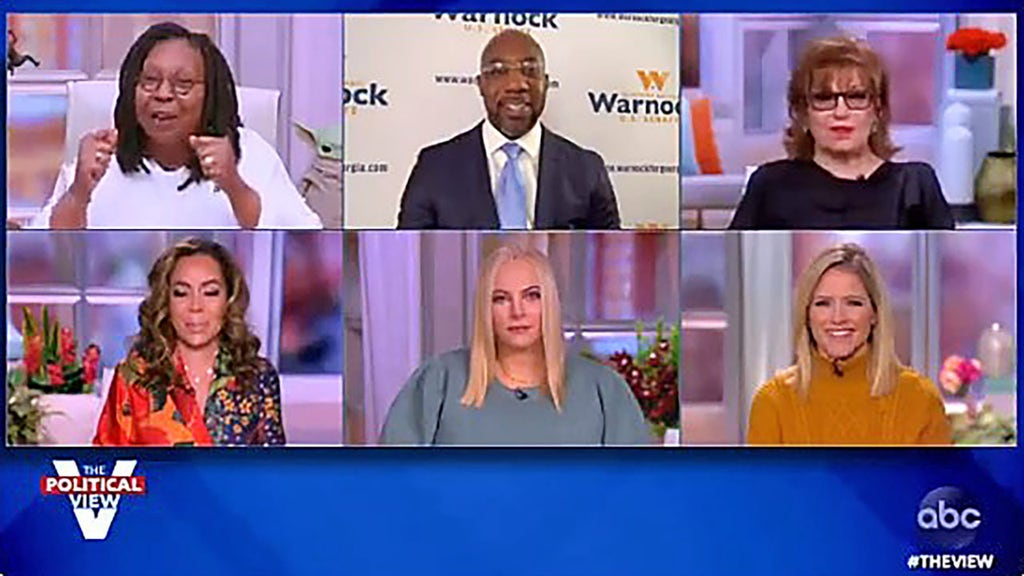 Whoopi cuts off McCain as she attempts to press Warnock to answer questions
