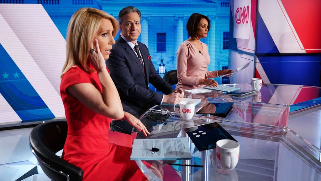 CNN anchors let insults, condemnations fly as Trump leaves the White House