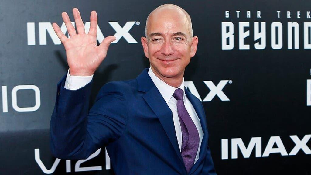 Bezos waving