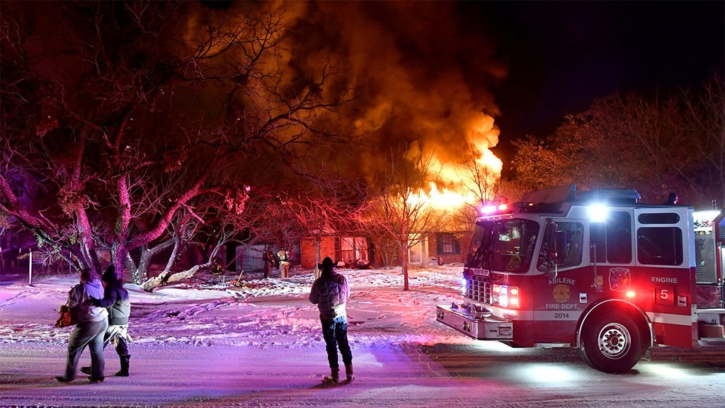 Home burns as extreme cold freezes hydrants; millions battle deadly cold