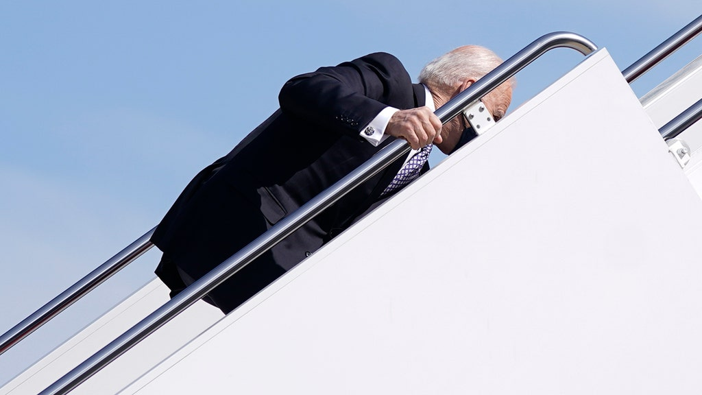 Biden stumbles while climbing Air Force One stairs, WH official blames wind