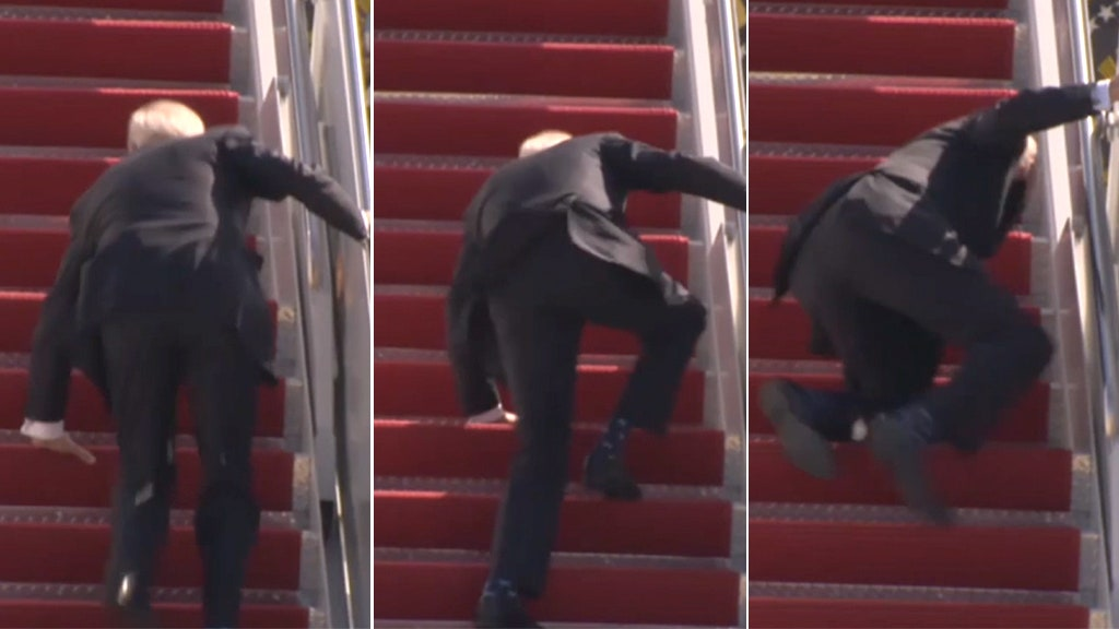 Biden stumbles multiple times, falls as he climbs Air Force One stairs