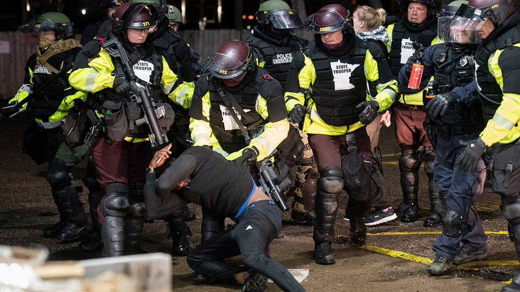 Minn. cops fire flash-bang grenades during second night of unrest
