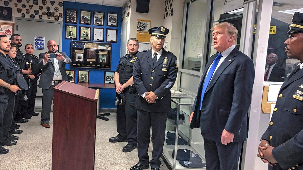 Trump pays tribute to 9/11 heroes while meeting with NYPD officers