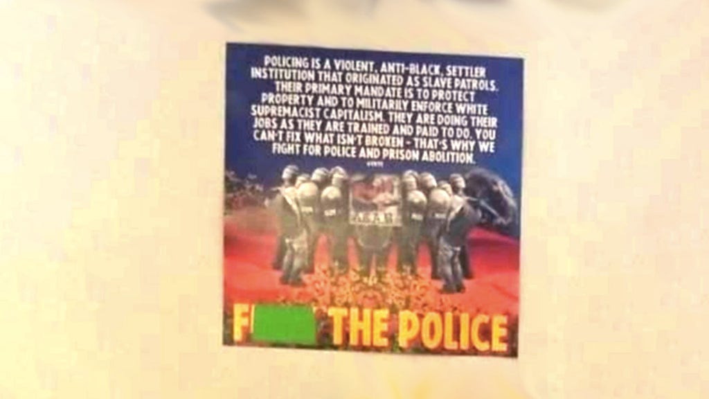 Teacher puts up profane, anti-American posters in class at taxpayer's expense