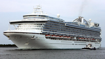 After an incident aboard the Crown Princess, the cruise ship returns to the port at Cape Canaveral, Fla. on Tuesday, July 18, 2006. The Crown Princess suddenly rolled heavily to its left Tuesday, throwing passengers and crew to the deck and leaving two people critically injured, including a child, officials said.(AP Photo/John Raoux)