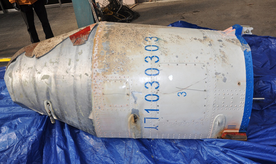 In this photo provided by the South Korean Defense Ministry, an object that the South Korean Defense Ministry believes to be a part of a North Korean rocket is displayed on a South Korean navy ship Tuesday, Feb. 9, 2016, in undisclosed location, South Korea. While government leaders around the world are trying to figure out how to punish North Korea for its Feb. 7 rocket launch, the U.S., Japanese and South Korean militaries are scouring the seas for debris and analysts are studying photos, trajectories - anything that might provide insight into North Korean rocketry skills. (South Korean Defense Ministry via AP)