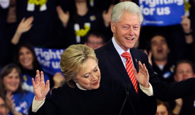 Democratic presidential candidate Hillary Clinton reacts as former President Bill Clinton smiles at her New Hampshire presidential primary campaign rally, Tuesday, Feb. 9, 2016, in Hooksett, N.H. (AP Photo/Elise Amendola)