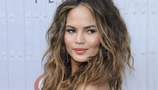 Chrissy Teigen topless on Snapchat