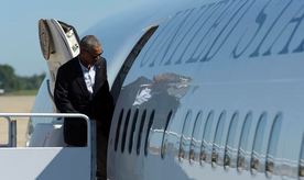 President Barack Obama walks boards Air Force One at Andrews Air Force Base, Md., Tuesday, Aug. 23, 2016. Obama is making his first visit to flood-ravaged southern Louisiana as he attempts to assure the many thousands who have suffered damage to their homes, schools and businesses that his administration has made their recovery a priority. (AP Photo/Susan Walsh)