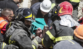 An injured man is carried on a stretcher by rescuers following an earthquake in Accumoli, central Italy, Wednesday, Aug. 24, 2016. The magnitude 6 quake struck at 3:36 a.m. (0136 GMT) and was felt across a broad swath of central Italy, including Rome, where residents felt a long swaying followed by aftershocks. The temblor shook the Lazio region and Umbria and Le Marche on the Adriatic coast. (Angelo Carconi/ANSA via AP)