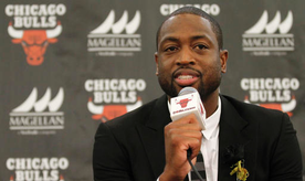 """FILE- In this July 29, 2016, file photo, Chicago Bulls player Dwyane Wade speaks during a news conference in Chicago. A family spokesman says a cousin of Wade's was fatally shot Friday, Aug. 25, while pushing a baby in a stroller on the city's South Side. Wade posted on Twitter: """"My cousin was killed today in Chicago. Another act of senseless gun violence. 4 kids lost their mom for NO REASON. Unreal."""" (AP Photo/Tae-Gyun Kim, File)"""