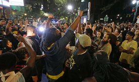 Protesters shout as they march downtown on the third night of protests in Charlotte, N.C. Thursday, Sept. 22, 2016, following Tuesday's fatal police shooting of Keith Lamont Scott in Charlotte, N.C. (AP Photo/Chuck Burton)