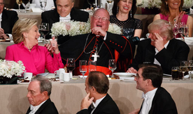 Republican presidential candidate Donald Trump, right, Cardinal Timothy Dolan, Archbishop of New York, center, and Democratic presidential candidate Hillary Clinton share a laugh during the Alfred E. Smith Memorial Foundation dinner, Thursday, Oct. 20, 2016, in New York. (AP Photo/ Evan Vucci)