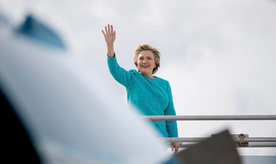 Democratic presidential candidate Hillary Clinton waves before boarding her campaign plane at Miami International Airport in Miami, Wednesday, Oct. 26, 2016, to travel to Lake Worth, Fla. for a rally. Today is Clinton's 69th birthday. (AP Photo/Andrew Harnik)
