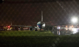 Republican vice presidential candidate Indiana Gov. Mike Pence's campaign airplane sits partially on the tarmac and the grass after sliding off the runway while landing at LaGuardia airport, Thursday, Oct. 27, 2016, in New York. (AP Photo/Mary Altaffer)