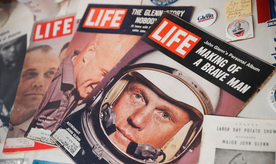 A Sept. 1966 edition of LIFE Magazine bearing the likeness of John Glenn rests in a showcase at the John & Annie Glenn Museum, Friday, Dec. 9, 2016, in New Concord, Ohio. Glenn was the first American to orbit Earth, piloting Friendship 7 around the planet three times in 1962. Glenn, as a U.S. senator at age 77, also became the oldest person in space by orbiting Earth with six astronauts aboard shuttle Discovery in 1998. (AP Photo/John Minchillo)