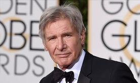 """FILE - In this Jan. 10, 2016 file photo, Harrison Ford arrives at the 73rd annual Golden Globe Awards in Beverly Hills, Calif. Newly released video shows a plane piloted by Ford mistakenly flying low over an airliner that was taxiing at a Southern California airport. The 45 seconds of video released Tuesday, Feb. 21, 2017, shows the 74-year-old """"Star Wars"""" and """"Indiana Jones"""" star's potentially serious mishap at John Wayne Airport in Orange County. (Photo by Jordan Strauss/Invision/AP, File)"""