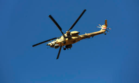 An Iraqi military helicopter prepare to attacks Islamic State group positions as Iraqi special forces advance towards the western side of Mosul, Iraq, Thursday, Feb. 23, 2017. The advance comes as part of a major assault that started five days earlier to drive Islamic State militants from the western half of Mosul, Iraq's second-largest city. (AP Photo/ Khalid Mohammed)