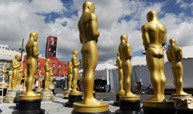 Oscar statues to be used for Sunday's 89th Academy Awards red carpet stand in a parking lot near Hollywood Boulevard on Wednesday, Feb. 22, 2017, in Los Angeles. (Photo by Chris Pizzello/Invision/AP)