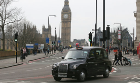 "A black cab drives past as Westminster Bridge is re-opened to the public Thursday, March 23, 2017, following an attack on Wednesday when a man drove a car into pedestrians then stabbed a police officer to death before being fatally shot by police within Parliament's grounds. The IS-linked Aamaq news agency said Thursday that the person who carried out the ""attack in front of the British parliament in London was a soldier of the Islamic State."" (AP Photo/Tim Ireland)"